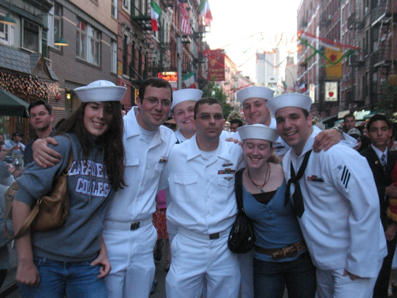 Fleet week sailors with girls in the village.