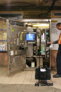 A Metrocard mechanic cleaning some parts of the machine.